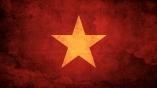 Vietnam-Flag-on-Red-Grunge-Wall